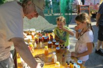The girls, sampling the many varieties of honey