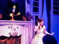 Lumiere and Belle, playing to the audience