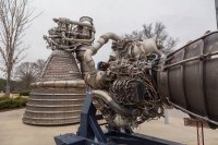 Space shuttle main engine and F1 in front of the Marshall main building
