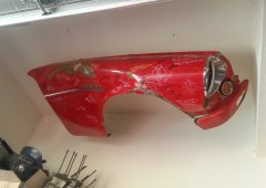 The original fender, now a piece of artwork in my garage